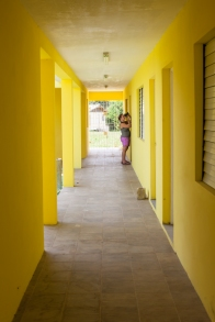 An open air hallway connects the classrooms.