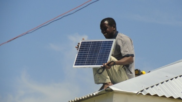 Installing solar panel on roof to run lighting.