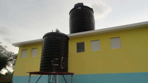 Both tanks installed! The top is for potable water and is filled using a solar powered pump from a water supply 1,000 feet away. The bottom collects rainwater from the roof. Both use gravity for water pressure.