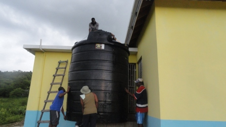 Hoisting a 2,000 gallon tank onto school roof - to use for potable water along with a solar pump from the clean water source..