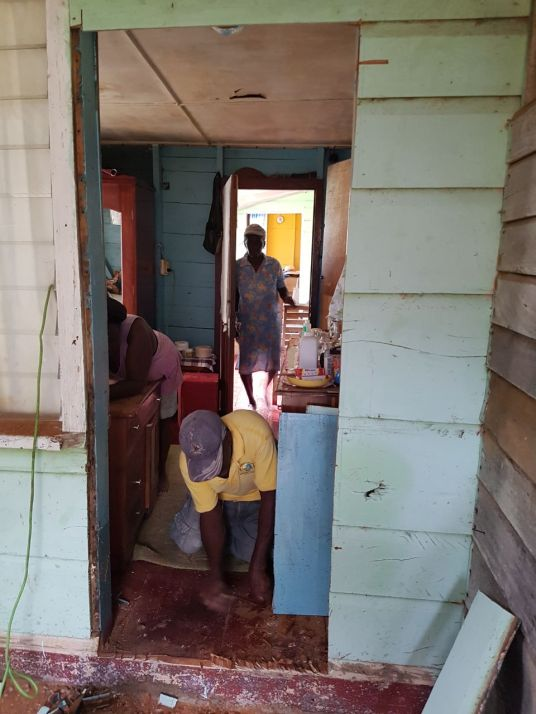 After the Jah Works team left, the community continued to work to add an internal door from the bedroom into the bathroom.