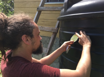 Cofounder, Brandon, adds the final decor to the final install of the week!
